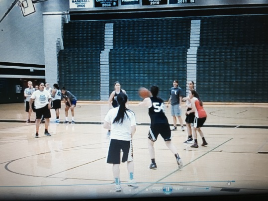 A transition drill, in which Coach Carly is yelling and Coach Krystal looks tired.